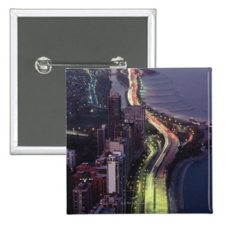 Aerial view of buildings along a highway in a pinback button