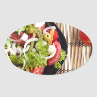 Aerial view of one portion of vegetable salad oval sticker