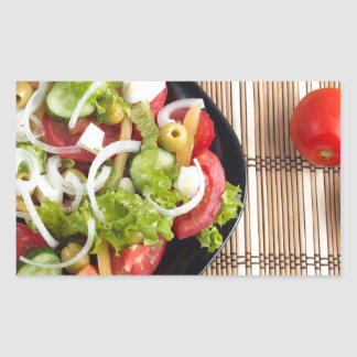 Aerial view of one portion of vegetable salad rectangular sticker
