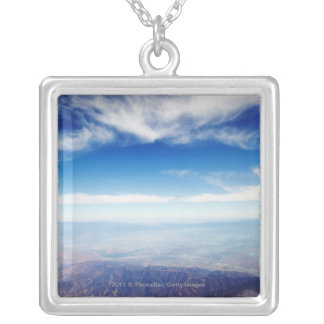 Aerial view of red brown mountains silver plated necklace