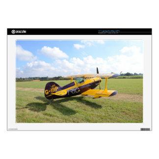 Aerobatic Bi-Plane On The Field Laptop Skins