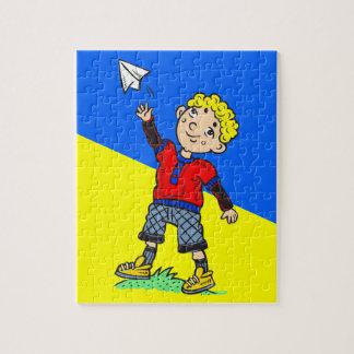 Aeroplano de papel que vuela del muchacho puzzles