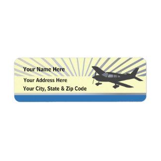 Aeroplano del ala baja etiquetas de remite
