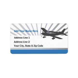 Aeroplano del ala baja etiqueta de dirección