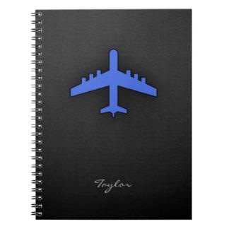 Aeroplano del azul real libro de apuntes con espiral