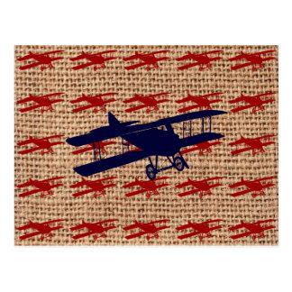 Aeroplano del propulsor del biplano del vintage en postal