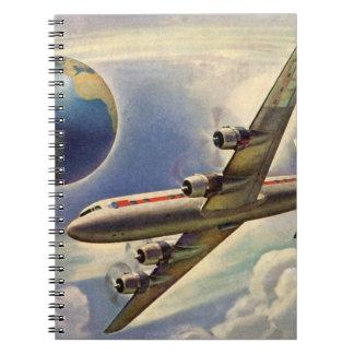 Aeroplano del vintage que vuela en todo el mundo libretas