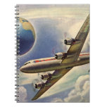 Aeroplano del vintage que vuela en todo el mundo e libretas