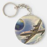 Aeroplano del vintage que vuela en todo el mundo e llaveros personalizados