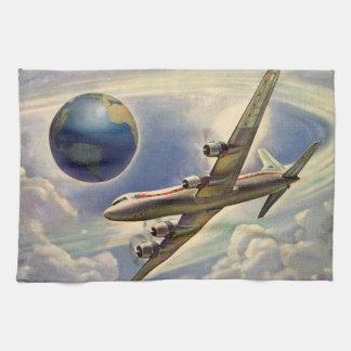 Aeroplano del vintage que vuela en todo el mundo e toalla de cocina