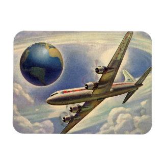 Aeroplano del vintage que vuela en todo el mundo iman de vinilo