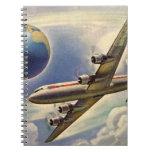 Aeroplano del vintage que vuela en todo el mundo libreta