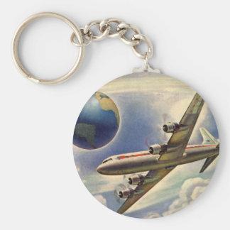 Aeroplano del vintage que vuela en todo el mundo llavero redondo tipo chapa