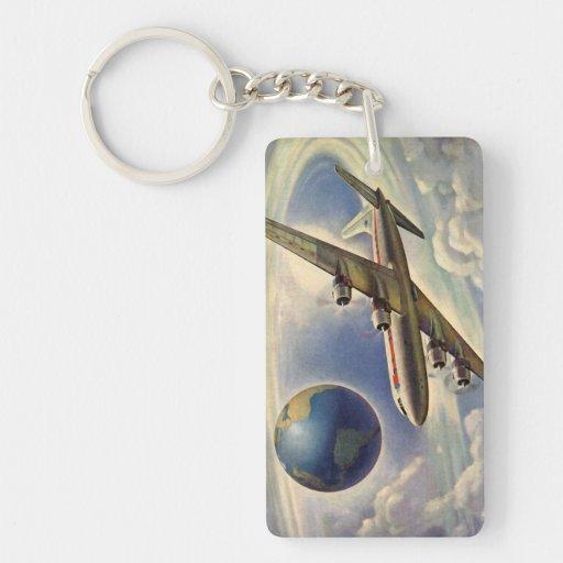 Aeroplano del vintage que vuela en todo el mundo llaveros