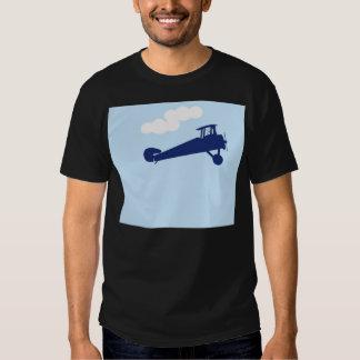 Aeroplano en fondo azul en colores pastel llano camisas