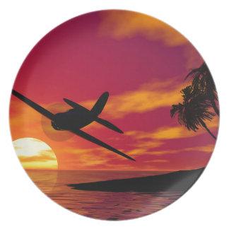 Aeroplano en una puesta del sol tropical plato de cena