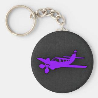 Aeroplano púrpura violeta llavero redondo tipo pin