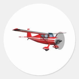 Aeroplano rojo pegatina redonda