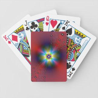 Aerosol floral en naipes rojos barajas de cartas