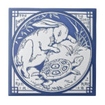 """Aesop&#39;s Hare &amp; Tortoise Race Repro Minton TIle<br><div class=""""desc"""">From the Aesop&#39;s Fables series by Minton&#39;s China in a beautiful shade of blue. The transferware tile shows the tortoise passing a sleeping hare. The words on the tile read &quot;The hare and the tortoise run a race.&quot;  The original dates to the late 1800s.</div>"""