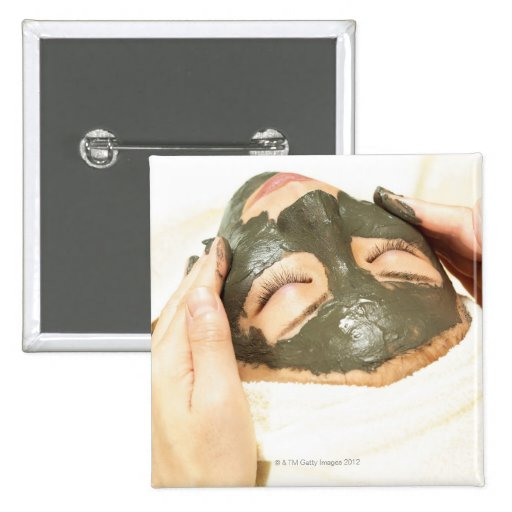 Aesthetician Who Rubs Mud Pack on Womans Face, Button