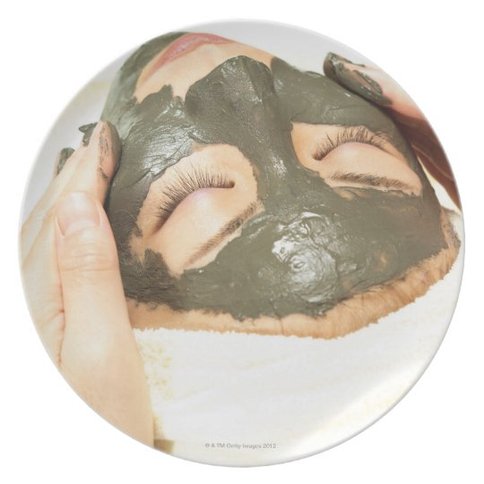 Aesthetician Who Rubs Mud Pack on Womans Face, Plate