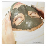 Aesthetician Who Rubs Mud Pack on Womans Face, Tiles
