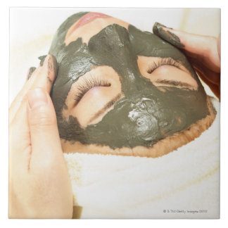 Aesthetician Who Rubs Mud Pack on Womans Face, Tile