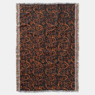 Afgano negro anaranjado floral del remolino del manta