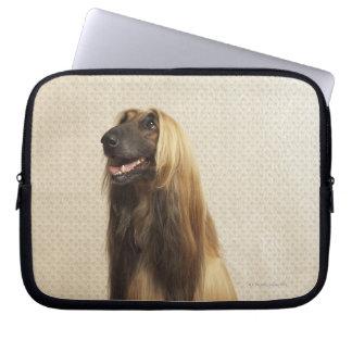 Afghan hound sitting in room 2 laptop computer sleeve