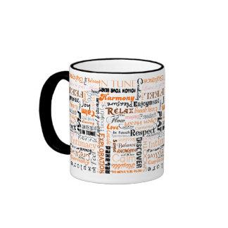 Afirmaciones sacras anaranjadas del positivo de taza de dos colores
