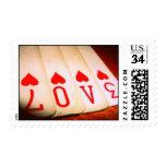 Afortunado en amor carda el sello
