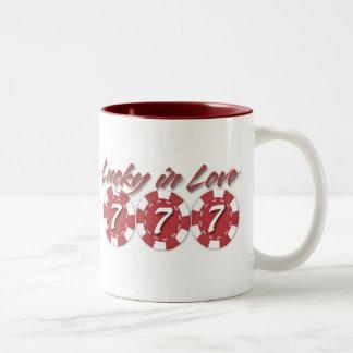 Afortunado en tazas de café del amor