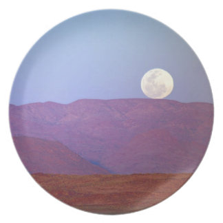 Africa, Namibia, Sossusvlei. A full moon rests Dinner Plates