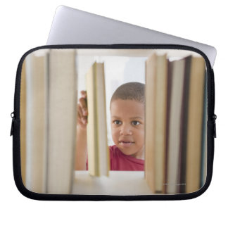 African American boy selecting book Laptop Sleeve