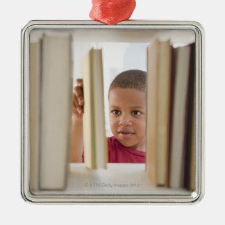 African American boy selecting book Metal Ornament