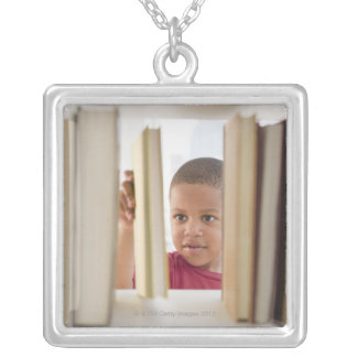 African American boy selecting book Jewelry