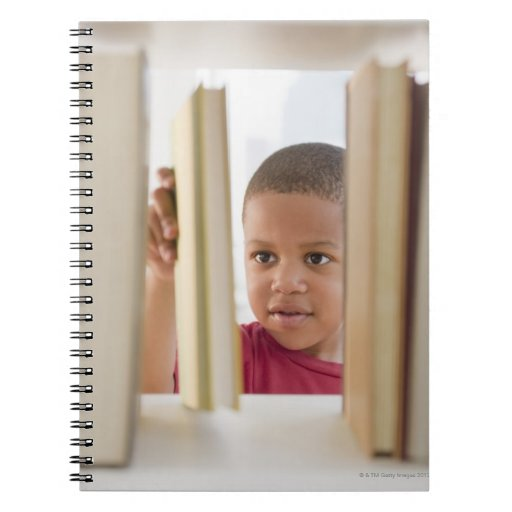 African American boy selecting book Spiral Note Book