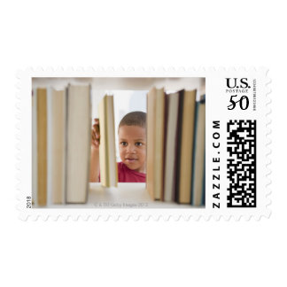 African American boy selecting book Postage