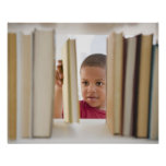 African American boy selecting book Posters