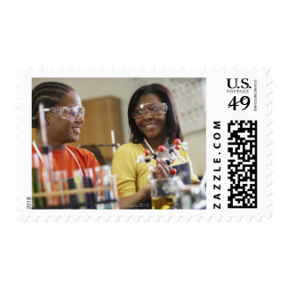 African American teenagers in science class Postage