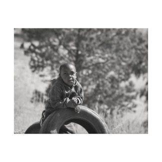 African Boy with Tire Canvas Print