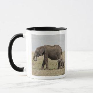 African Elephant mother with baby walking Mug