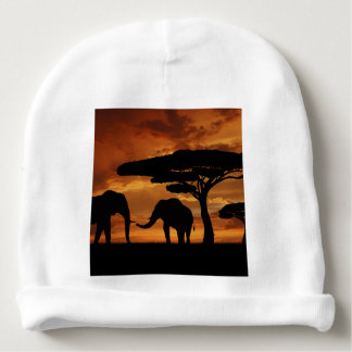 African elephants silhouettes in sunset baby beanie