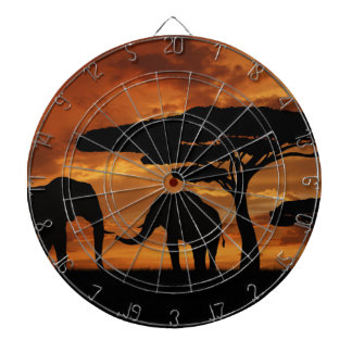 African elephants silhouettes in sunset dartboard