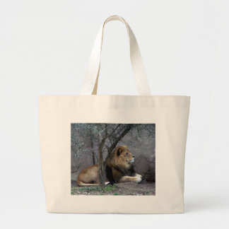 african lion by tree large tote bag
