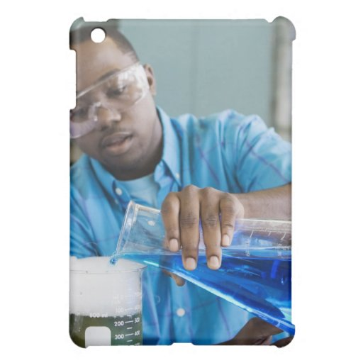 African man performing experiment in chemistry cover for the iPad mini