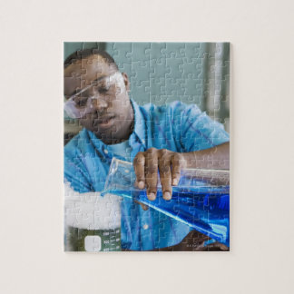 African man performing experiment in chemistry puzzle