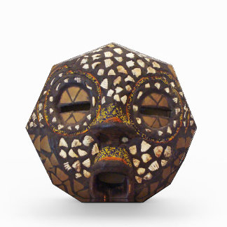 African mask with cowrie shells award