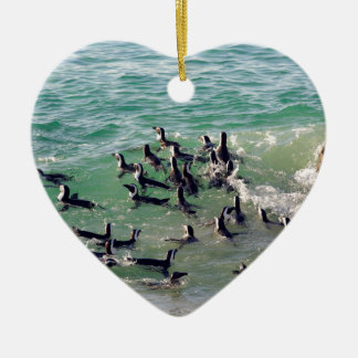 African penguins playing in the surf ceramic ornament
